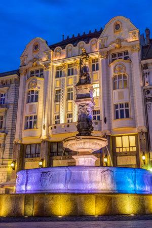 Maximilian fountain at old town square at night in Bratislava