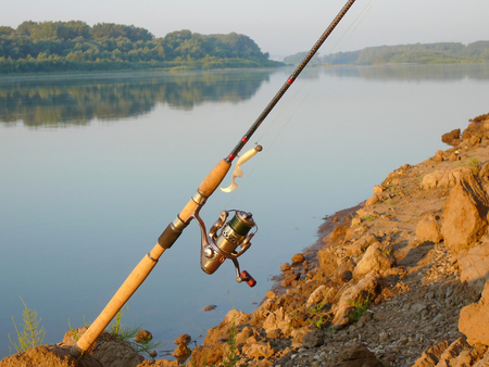 the spinning with jig-bait on the coast photo