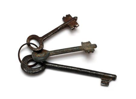 old rusty keys isolated on white photo