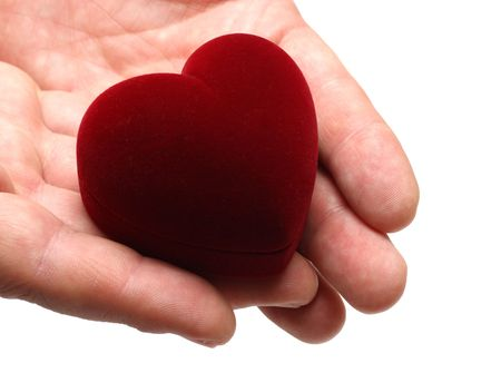 gifting: mans hands gifting heart on valentine day isolated on white