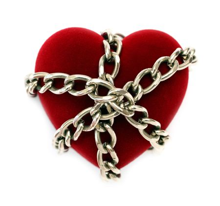 red heart locked with chain isolated on white photo