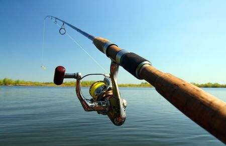 jigging: spinning and lake under blue sky Stock Photo