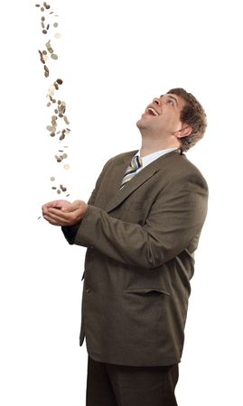 happy businessman catching falling money coins photo