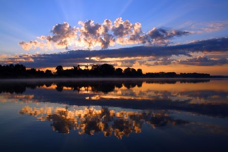 reflection sunrise with clouds on river Stock Photo - 3397441