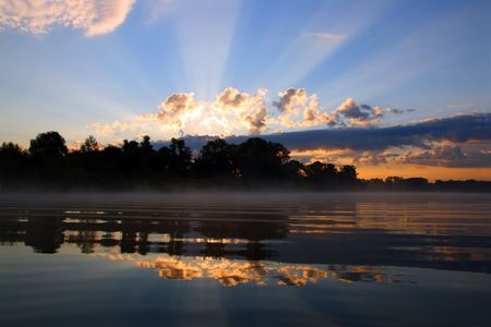 reflection sunrise with clouds on river Stock Photo - 3397440