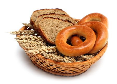 ears bread and bagels in basket isolated on white photo