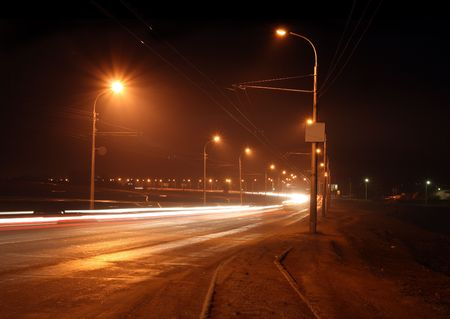 traffic ob night road with street lamps in fog Stock Photo