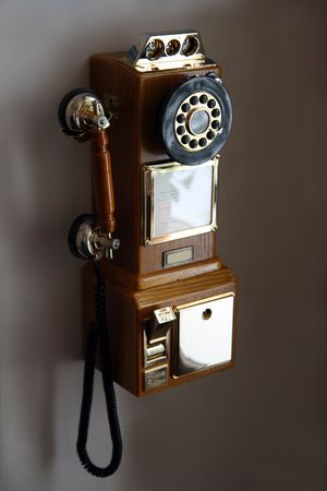 rotary dial telephone: old obsolete retro telephone on wall