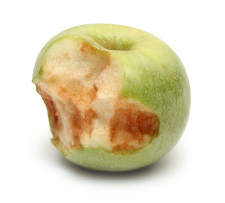 green bitten apple on white background photo
