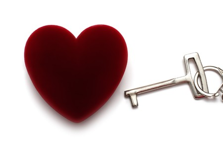 key to heart concept isoalted on white photo