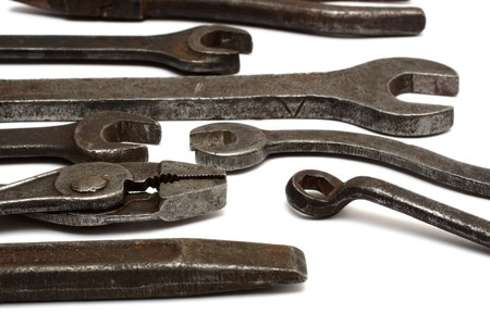 old dirty tools - spanners and pliers - isolated on white photo