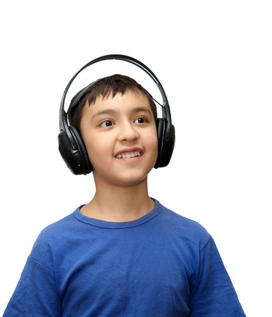 deafening: boy listening music in headphones isolated on white