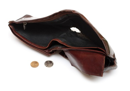 coin purse: battered empty purse with tear isolated on white