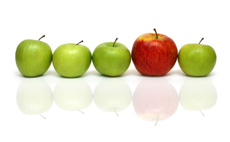 different concept: different concepts - red apple between green apples Stock Photo