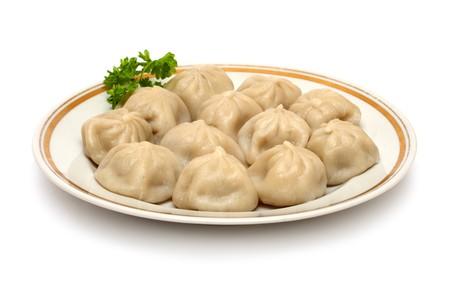 russian ravioli (pelmeni) on plate isoalted on white Stock Photo