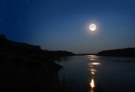 silver stars: night landscape with moon and moonbeam in river Stock Photo