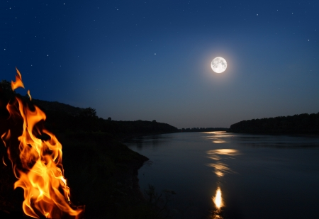 campfires: night landscape with bonfire and moonbeam in river