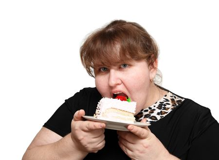 overweight woman greedy biting sweet cake Stock Photo
