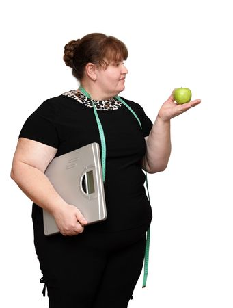 dieting overweight women with scales and apple photo