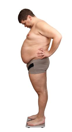 overweight man from one side standing on scales photo