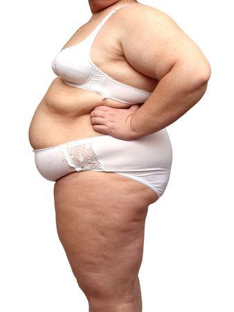 mujer gorda: exceso de peso corporal en la mujer aislada en la ropa interior de color blanco Foto de archivo