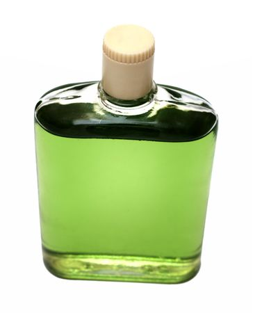old bottle with green cologne isolated on white photo