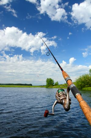 jigging: spinning with reel and summer lake