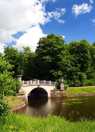 bridge across pond in pavlovsk park saint-petrersburg russia photo