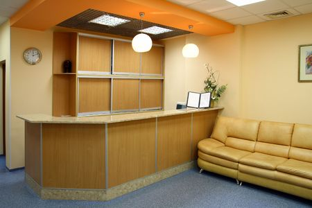 hotel reception: reception room interior with counter and sofa Stock Photo