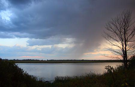 lake landscape with rain in dusk Stock Photo - 5453039