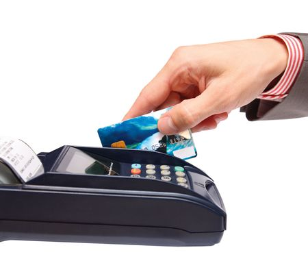 transaction - men hand with credit card in payment terminal Stock Photo