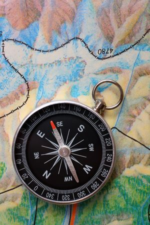 earth road: compass on geography map - orientation concept Stock Photo
