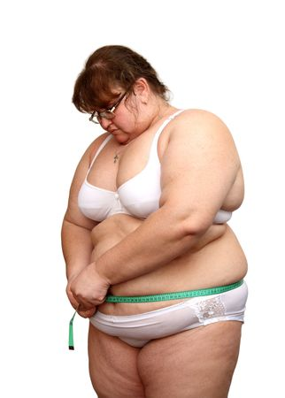 abstinence: overweight woman in underwear measure her stomach