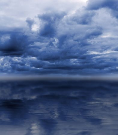 dull cloudy overcast sky over sea background photo