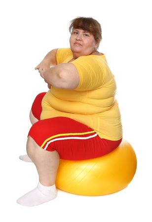 exercising overweight woman on ball isolated on white Stock Photo - 5946634