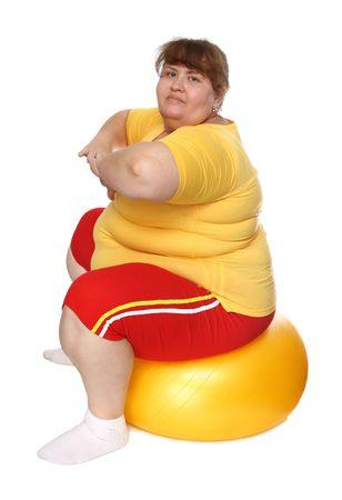 abdomen women: exercising overweight woman on ball isolated on white Stock Photo