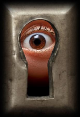 curiosity eye in keyhole - spy concept photo