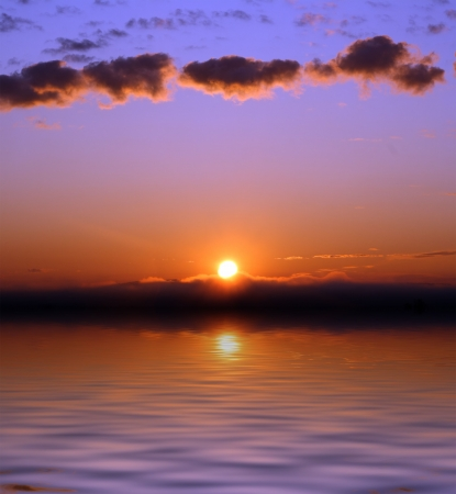 sunrise lake: beautiful sunrise with few clouds over sea
