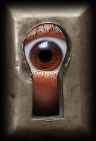 curiosity eye in keyhole - spy concept