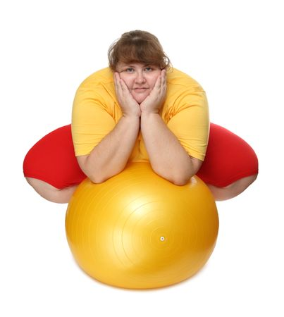 large ball: overweight woman sitting with gym ball on white Stock Photo