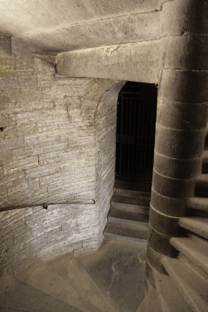 underground passage: dungeon with spiral staircase and arch doorway
