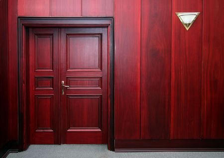 view of a wooden doorway: luxury mahogany wooden interior with closed door