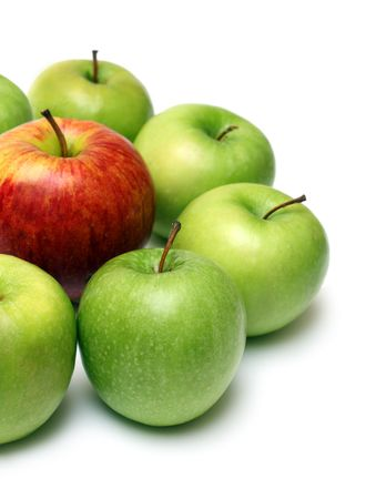 the chosen one: different concepts - green apples surround red apple Stock Photo