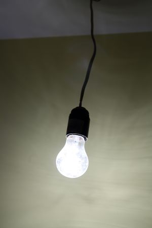 lighting dirty electrical lamp hanging on cable Stock Photo - 6443391