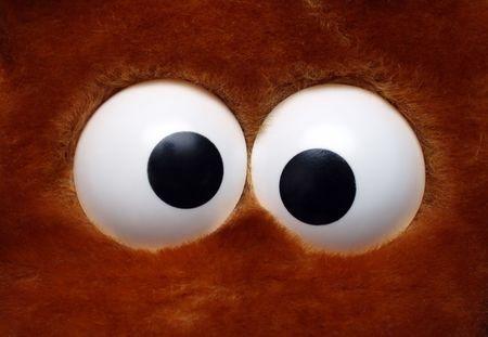 prank: close-up view on fun eyeballs of soft toy