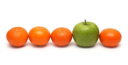 1 and group: different concepts - green apple between mandarins