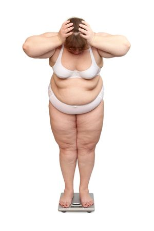 fat women: women with overweight in underwear on scales