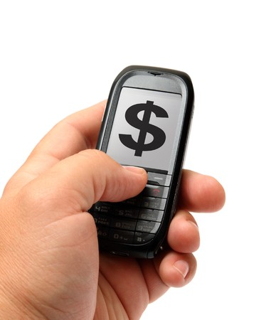 mobile phone in man hand with dollar sign photo