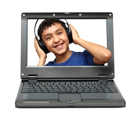 small laptop with child listening music in headphones Stock Photo - 7464024