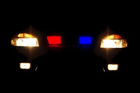 bright headlights of police car at night photo